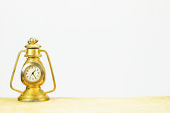 Rusty vintage table golden clock on white background Royalty Free Stock Image