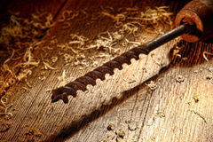 Rusty Vintage Wood Drill Bit on Antique Wood Board Stock Images