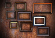 Rusty wall full of empty frames Stock Images