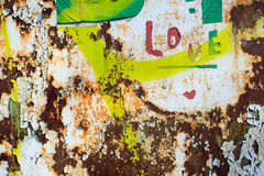 Rusty wall with label love Stock Images