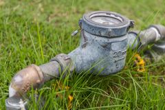Rusty Water Meter on Lawn Stock Photos