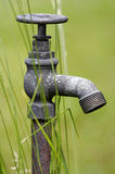 Rusty water supply point Stock Image