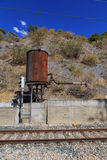 Rusty water tank near tracks Royalty Free Stock Photos