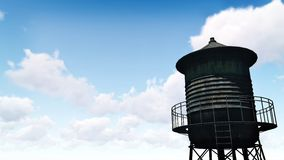 Rusty water tower against blue cloudy sky Stock Image