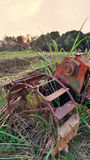 Rusty Water wheel in the rice field Royalty Free Stock Photos