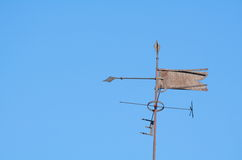 Rusty Weather Vane. Old Rusty Metal Weather Vane with Clear Blue Sky stock photo