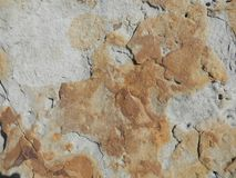 Rusty Weathered Sandstone Rock Background. Rusty coloured weathered sandstone rock background image Stock Photography