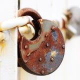 Rusty wedding lock hanging at the bridge Stock Photo