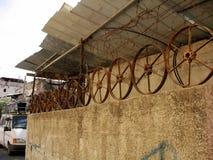 Rusty wheel as  fence Stock Photo