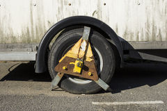 Rusty wheel clamp Stock Images