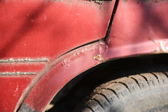 Rusty wheel and cracked paint of very old car Stock Photos