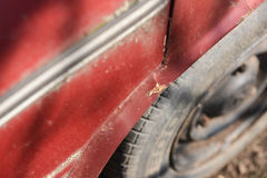 Rusty wheel and cracked paint of very old car Stock Photography