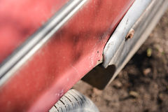Rusty wheel and cracked paint of very old car Stock Image