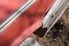 Rusty wheel and cracked paint of very old car Stock Images
