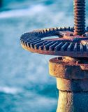 Rusty Wheel And Gear of Sluice Valve With Spider Web stock photo