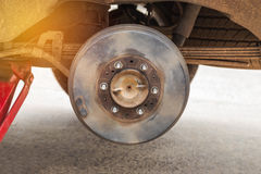 Rusty wheel hub car with drum brake system during change wheel tyre. Rusty wheel hub car with drum brake system and suspension during change wheel tyre Royalty Free Stock Images