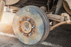 Rusty wheel hub car with drum brake system and suspension Stock Image