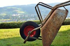 Rusty wheelbarrow - close-up Stock Image