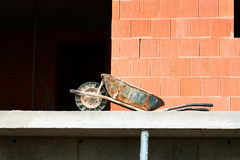 Rusty wheelbarrow left on construction site Royalty Free Stock Photography