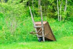 Rusty wheelbarrow Stock Images