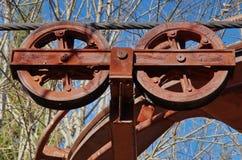 Rusty wheels - abandoned ski lift Royalty Free Stock Image