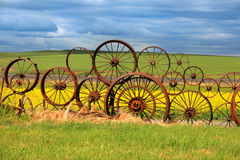 Rusty wheels fence. With scenic background Royalty Free Stock Photos