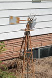 Rusty windmill out in the yard Royalty Free Stock Photo