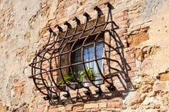 Rusty Window Grate - Pienza Stock Photo