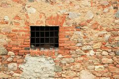 Rusty window grille and old brick wall Royalty Free Stock Photos
