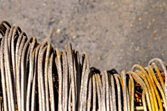 Rusty wire coils. Close up image of coils of rusty steel wire stock image