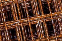 Background with rusty grid. Construction and industrial theme. Rusty Wire Mesh Macro Closeup against White Cement Floor as Metal Grid Net Seamless Abstract Stock Photo