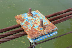 Rusty wire rope sling of the part of the bridge. Stock Photography