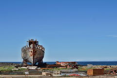 Rusty wooden and metal shipwreck in the Icelandic dry dock in the Akranes town as a symbol of corrosion and decay. Rusty wooden and metal shipwreck in the royalty free stock image