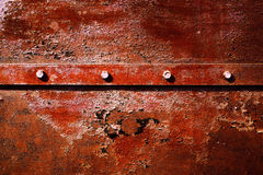 Rusty worn and scratched metallic background Stock Image