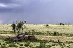 Rusty wreckage of a car. Old rusty wreckage of a car in a field alongside the road 66, New Mexico Stock Photography
