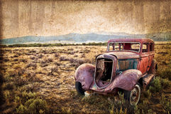 Rusty wrecked car. Vintage style royalty free stock photography