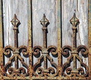 Rusty Wrought Iron Fence Detail. Rust and chipping paint add grungy detail to this old wrought iron gate Stock Image