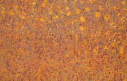 Rusty yellow metal surface. Saturated orange, red, grunge rusty metal texture background. royalty free stock photography