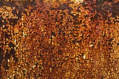 Rusty yellow paint on metal plate Royalty Free Stock Photo