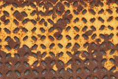 Rusty yellow walk grate background Royalty Free Stock Photo