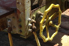 Rusty yellow wheel on valve Royalty Free Stock Images