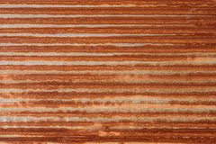 Rusty zinc corrugated iron metal siding. Stock Image