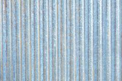 Rusty zinc corrugated iron metal siding. Rusty zinc corrugated iron metal siding for vintage background textured stock image