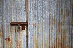 Rusty zinc door Stock Photo