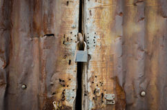 Rusty zinc door lock with key Royalty Free Stock Photography
