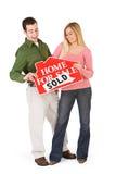 Ruszać się: Para Excited Sprzedawać Do domu Obrazy Stock
