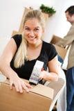 Ruszać się: Uśmiechnięte kobiet taśmy Up Boksują Zdjęcie Royalty Free