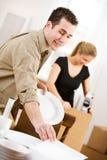 Ruszać się: Zawijać naczynia W Ochronnej pokrywie Zdjęcia Stock