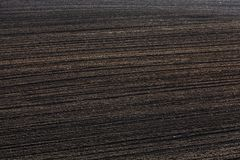 Soil arable land. Rut on a plowed agricultural field with black earth soil, closeup on arable land stock images