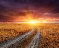 Rut road to sunset Stock Photos